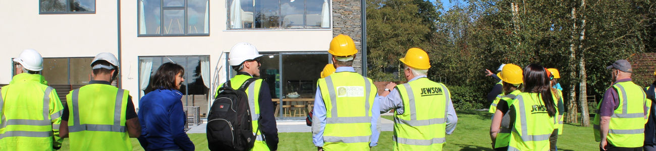 Delegates on a CAfS course on retrofitting buildings visit the site of a low-energy building, as part of the Cumbria Green Build Festival