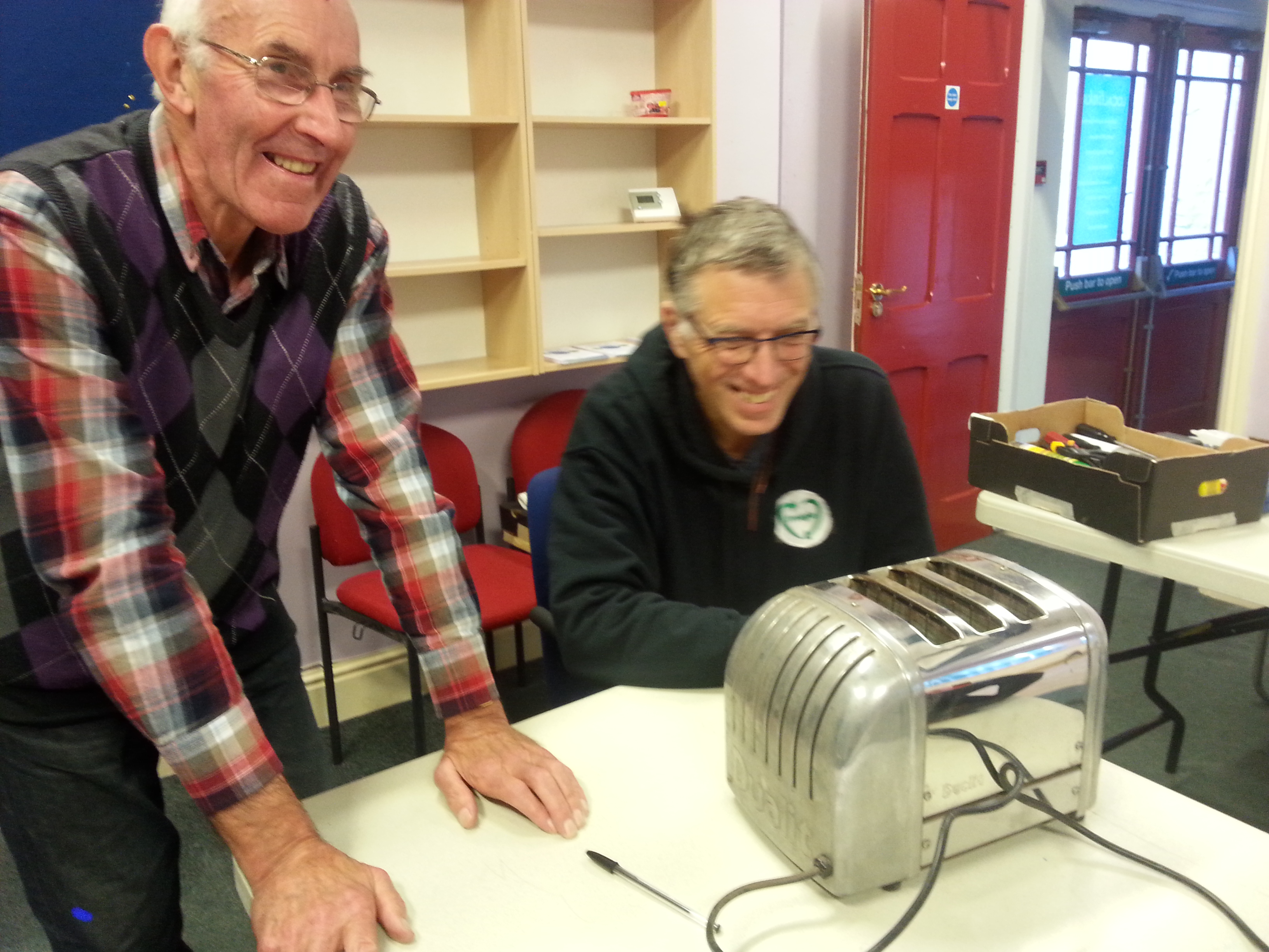 Volunteer Chris Cant fixing a toaster at Alston Moor Repair Cafe 23 Sept 2017 by CAfS