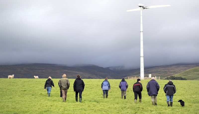 Visitors get up close to a wind turbine during Cumbria Green Build Festival by CAfS