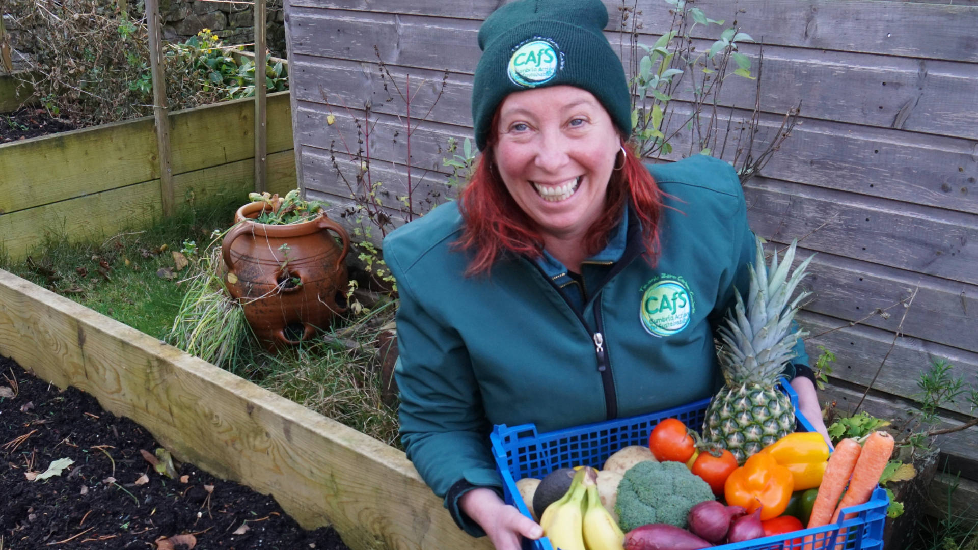 Roe Baker from CAfS by a veg bed, as Alston Moor food-growing study launched