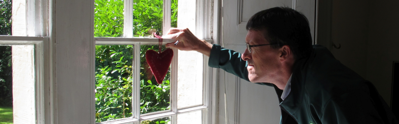 Andrew from CAfS checks for draughts at a sash window