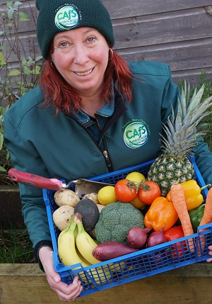 Roe Baker from CAfS with fruit and veg