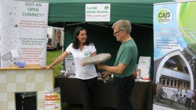 CAfS chief executive Hazel Graham offers advice on blocking chimney draughts using a Chimney Sheep, at a stall at an event