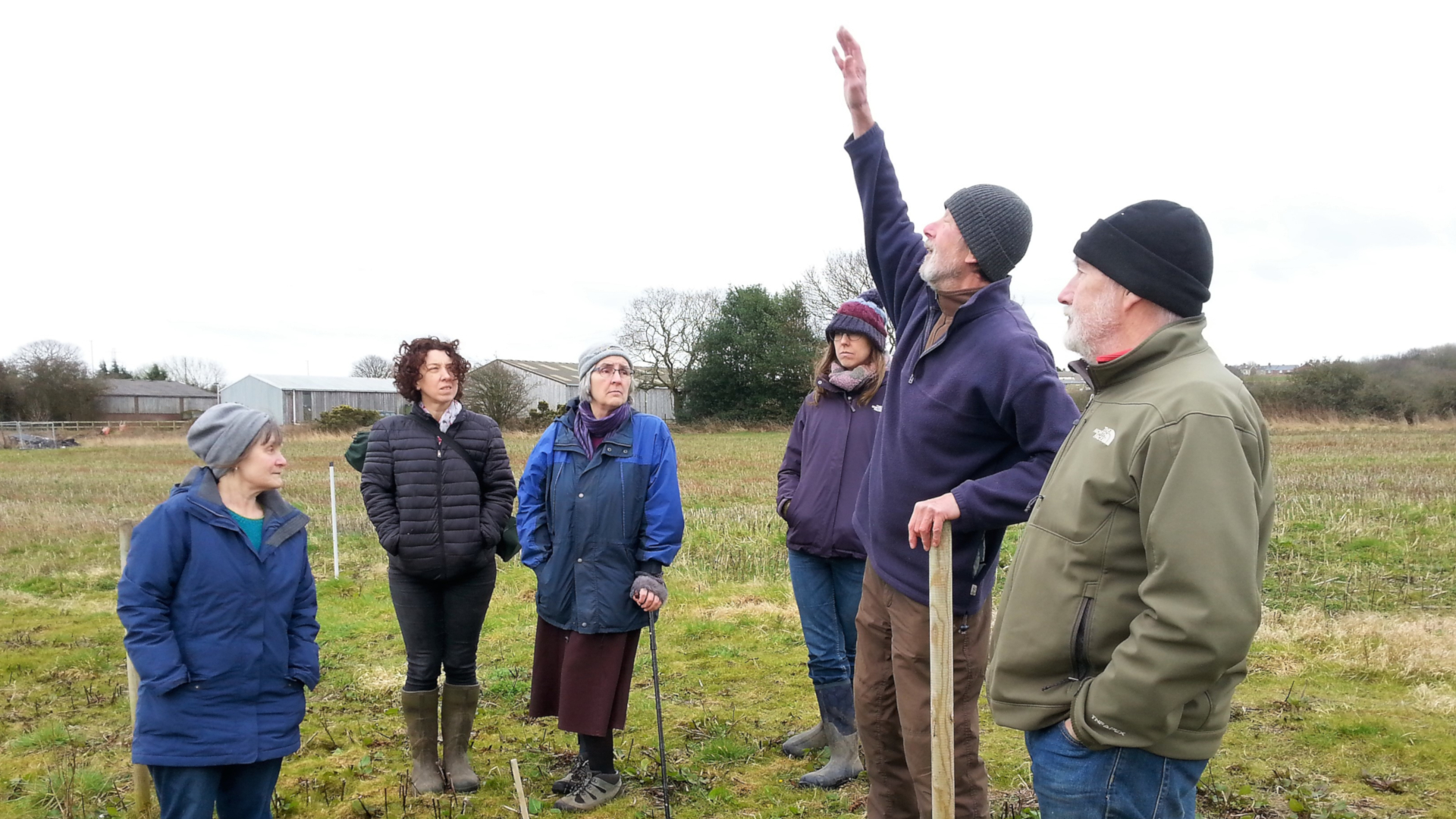 The Alston Moor community-led food growing team are shown around on a visit to the Gibside community farm
