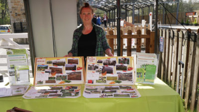 Roe Baker from CAfS running a stall at South Tynedale Railway Earth Day showing photos of options for food growing on Alston Moor