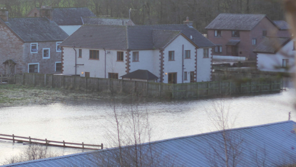 Houses at Eamont Bridge near Penrith surrounded by flood water during Storm Desmond Dec 2015