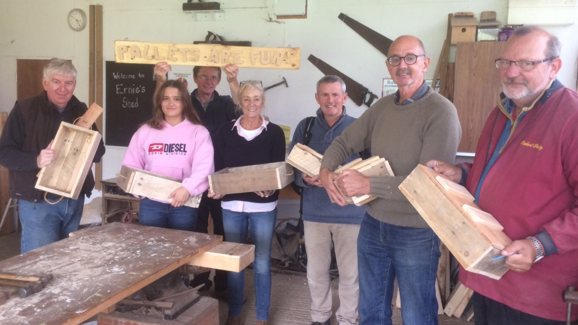 Delegates at the CAfS pallet workshop during 2018 Cumbria Green Build & Sustainable Living Festival hold up the boxes they've made