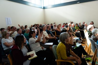 Attendees at Climate Emergency Action Summit take part in discussions