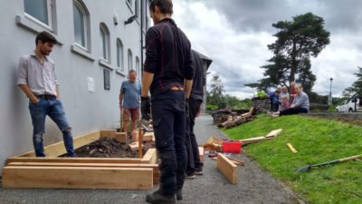 People building planters for community vegetable growing in Ambleside
