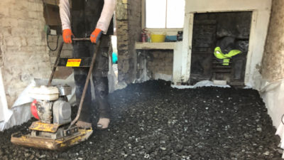 Installing the insulation layer of a limecrete floor at 33a Chapel St in Appleby