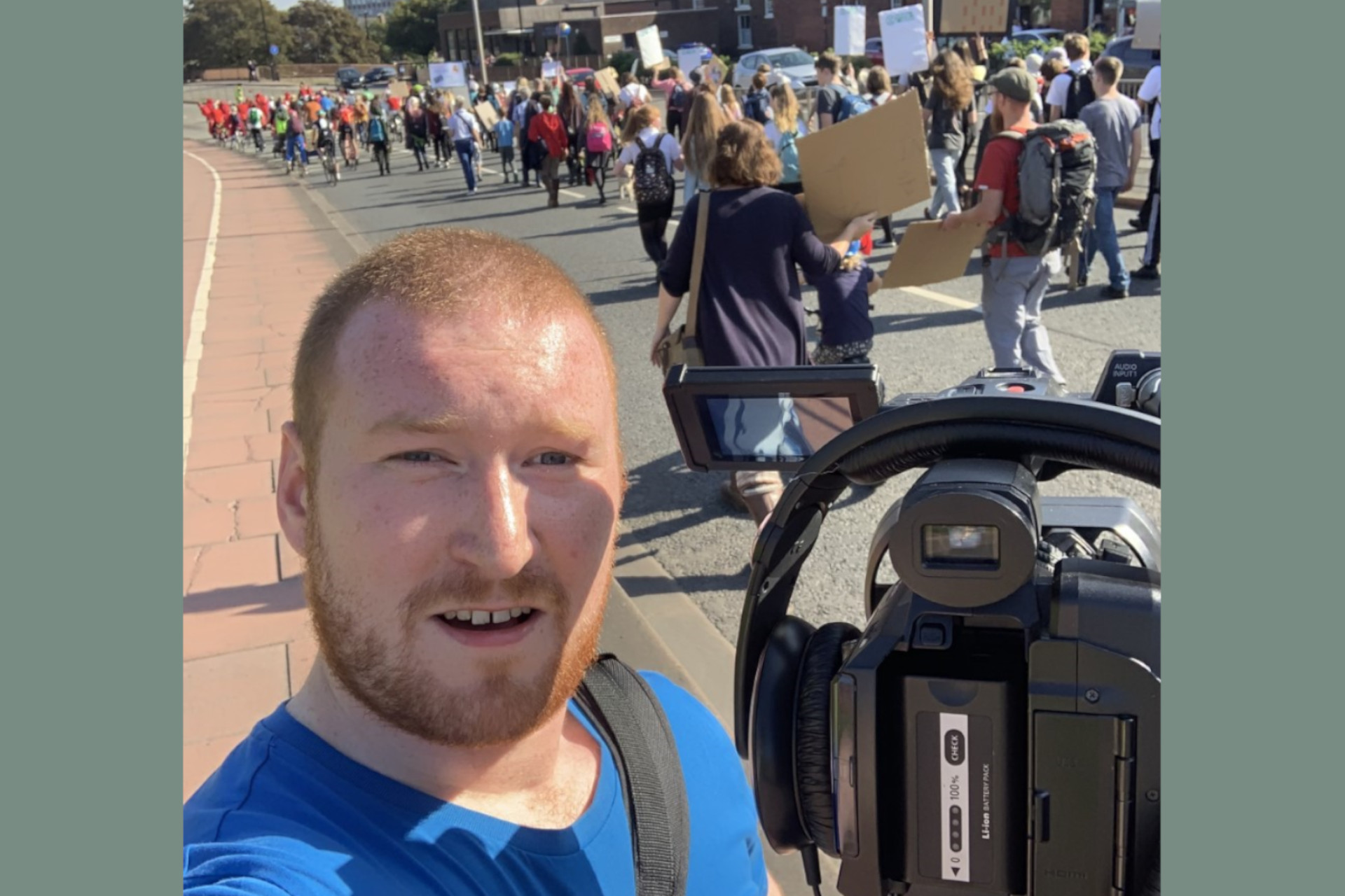 Kieran Macfadzean pictured filming Carlisle's Climate Strike in September 2019