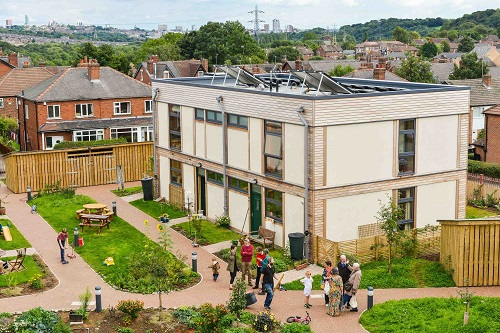 Residents enjoying the inspirational LILAC community housing development in Leeds. Photo: Andy Lord