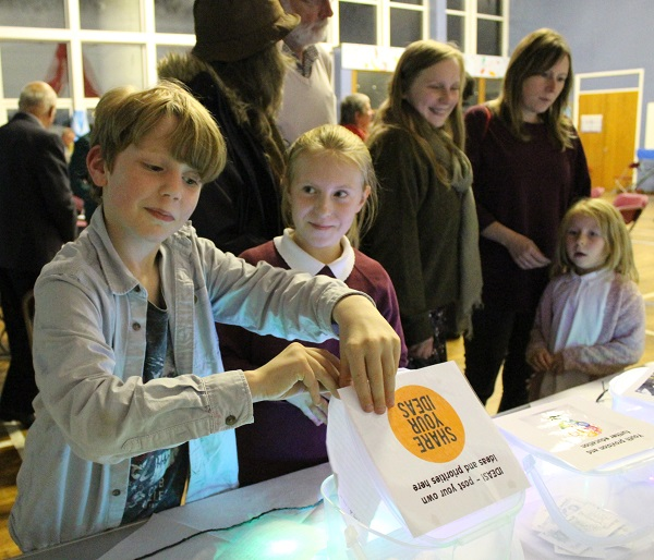 A boy casts a vote in community consultation as part of Alston Moor Greenprint project by CAfS