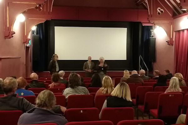 A screening with speakers and audience members