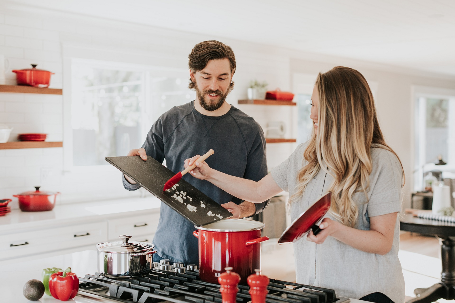 A man and a woman cooking together - Becca Tapert via Unsplash
