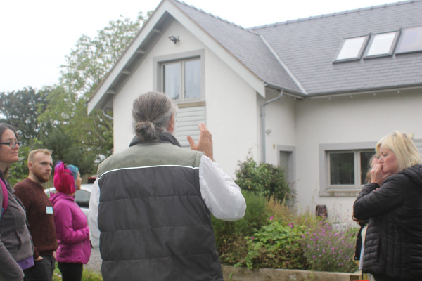 People looking at a green build home