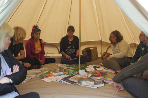 A group of people sitting in a teepee
