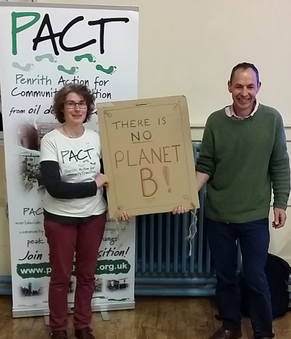 Jaki with mike berners lee holding a sign saying there is no planet b