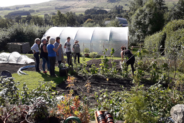 Outside the polytunnel watching a demonstration