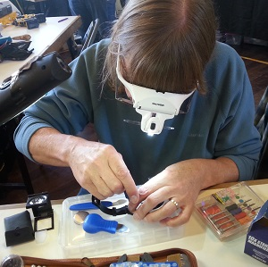A volunteer works on an item at the Alston Moor Repair Cafe supported by CAfS