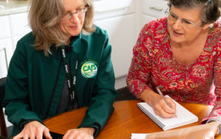 Tina from CAfS helping a Cold to Cosy Homes client to look for a cheaper tariff for energy bills